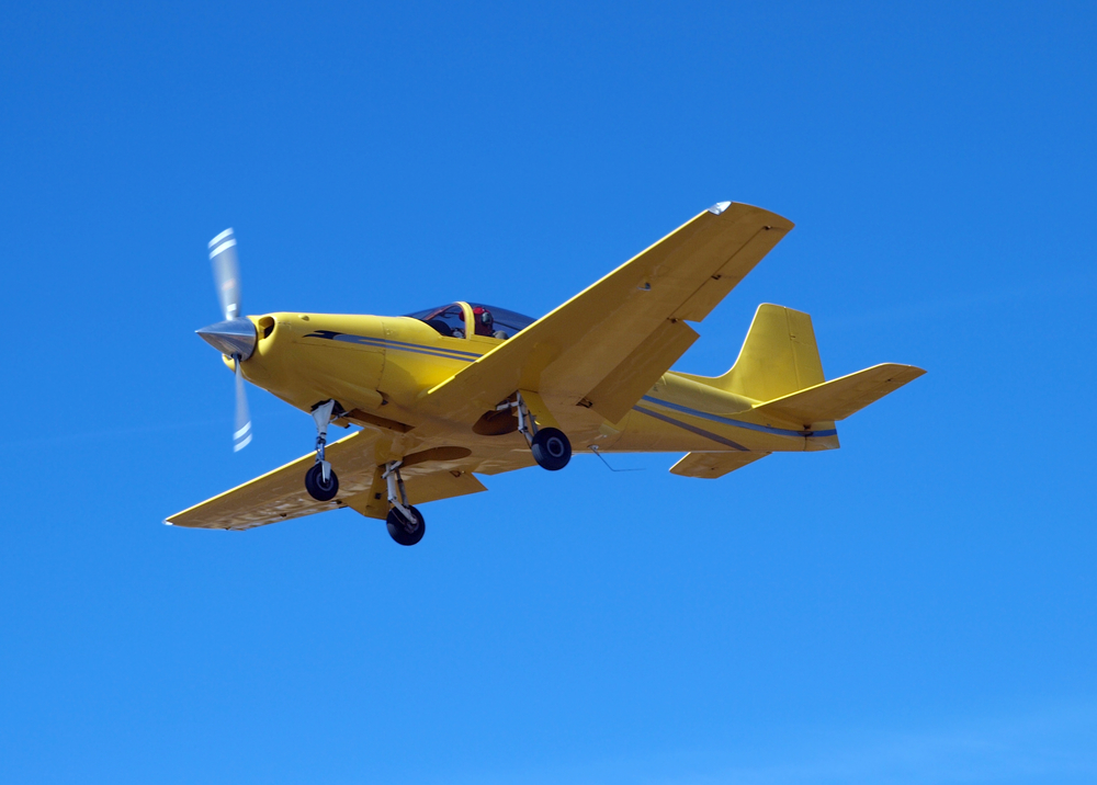 Image of small yellow plane.